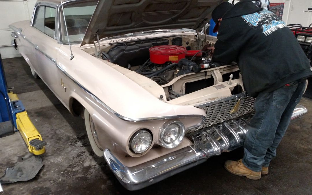 1961 Plymouth Fury Auto Repair and the loose clamp in Denver